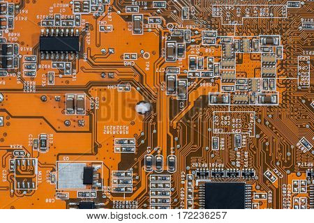 Old Orange Motherboard As Background. Electronic Components.
