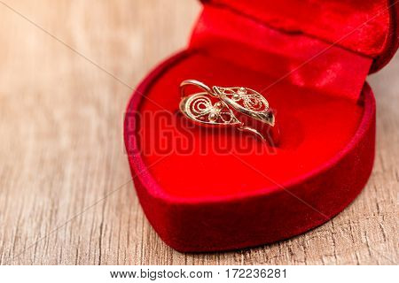 Gift Box With Gold Earrings On The Table.