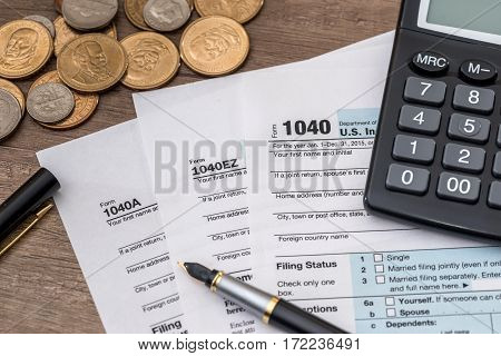 tax form concept - pen, money, calculator