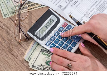 Business Lady Filling Tax Form. 2017. Financial Concept.