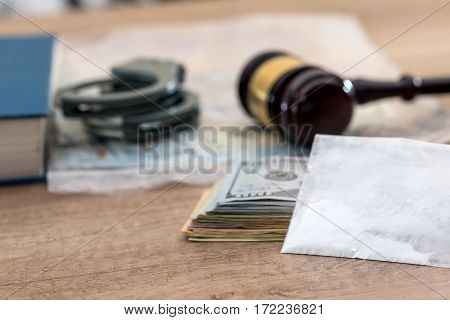 Drugs and substances prohibited dollar book Judge gavel and handcuffs - arrest criminals