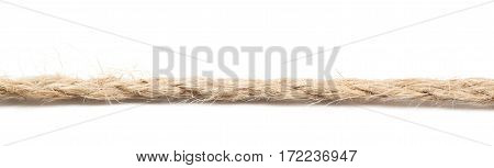 Line of a twisted decorational linen rope string isolated over the white background