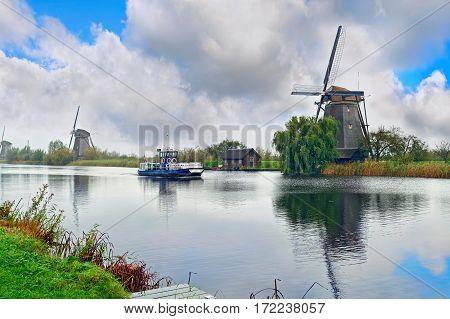 View of windmills (built around 1740) at village Kinderdijk in the northwest of the Alblasserwaard polder. The Netherlands.