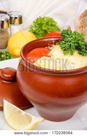 Mullet With Tomatoes Baked In A Clay Pot With A Cheese Crust, Decorated With Parsley