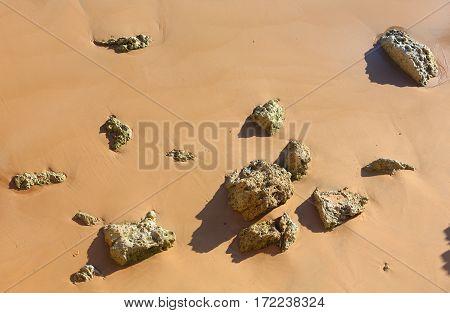 Rock Debris On Sand.