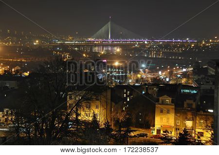 BELGRADE/ SERBIA - DEСEMBER 28. Belgrade at night. A view of the city center and the cable-stayed bridge on December 28, 2013. Belgrade, Serbia