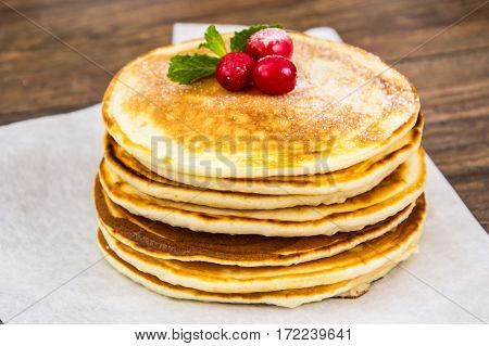 Tasty Pancake with cranberries and honey. Studio Photo