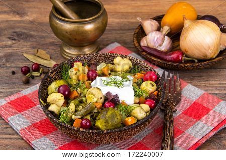 Vegetable stew with mushrooms in wooden bowl. Studio Photo