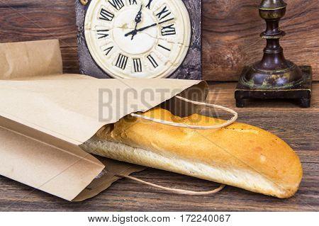 Fresh warm baguette in paper bag. Studio Photo