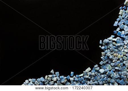 azul boquira granite, crushed granite blue on a black background