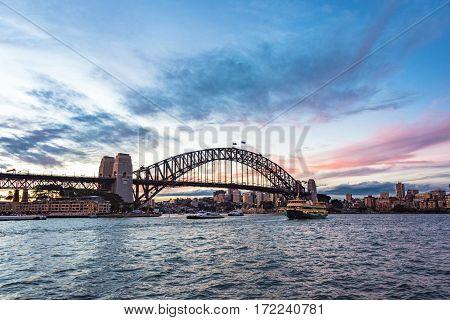 Australian Iconic Landmark Sydney Harbour Bridge Against Picturesque Sunset Sky