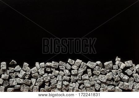 beautiful crushed granite gray on a black background