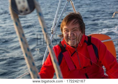 Happy man on his sailing boat.