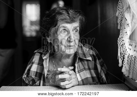 Elderly woman, black and white photo close-up.