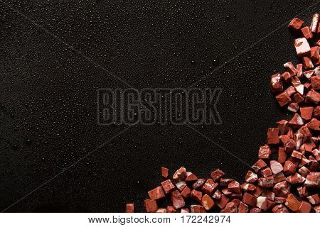 rosso levante, red marble on black background