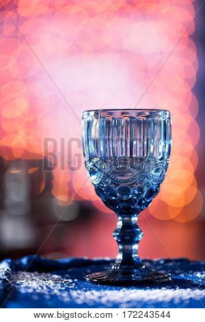 close-up of glass with copyspace and abstract lights background.