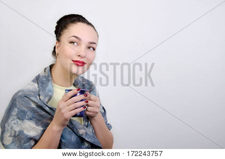 young woman with a cup in hands