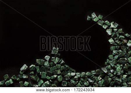 the crushed green marble on black background, verde guatemala