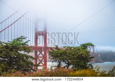 Golden Gate Bridge from Fort Point, south shore, San Francisco Bay, California, United States. Typical fog in summertime. Symbol, icon and landmark of San Francisco. Travel and holidays concept.