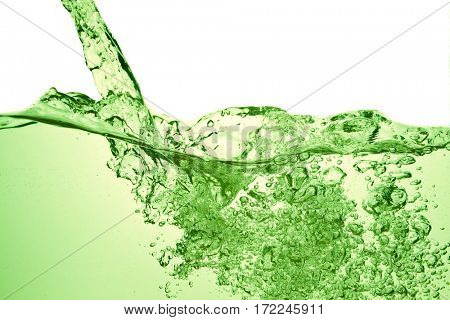 green soda drink with bubbles