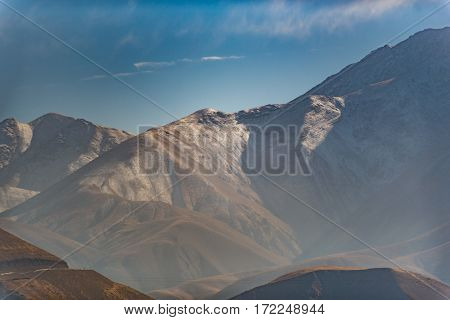 Fairy wild landscapes. Great mountains on sky background