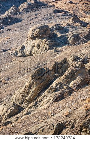 Various small rocks accumulation under scorching sun in Iranian district