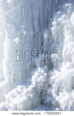Wonderful glacial mountain is full of various icicles. They are shimmering at sun