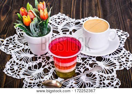 Fruit dessert multicolored jelly and espresso. Studio Photo