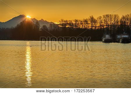Mount Baker Sunrise. The morning sun breaks over the top of Mount Baker in Washington State.