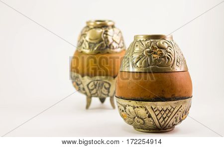 Two Argentinian Yerba Mate calabash cups with decorative silver