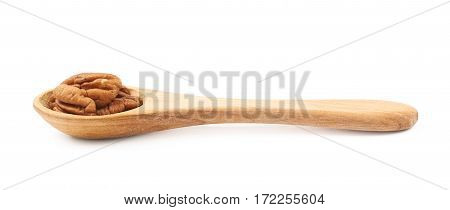 Wooden spoon full of pecan nuts isolated over the white background
