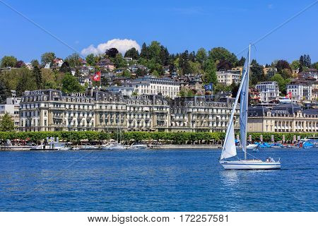 Lucerne, Switzerland - 8 May, 2016: people in boats on Lake Lucerne, buildings on the Nationalquai quay in the background. Lake Lucerne is a lake in central Switzerland the fourth largest in the country.
