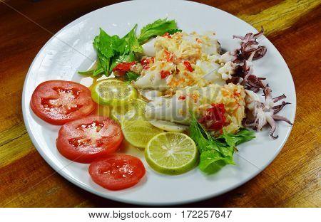 steamed squid stuffed minced pork dressing spicy lemon sauce on dish