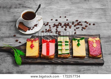 Breakfast for men. Figured snack sandwiches coffee chocolate. Sausage sandwiches cheese vegetables. Concept sandwiches Breakfast for day men father's day business lunch 23 February.