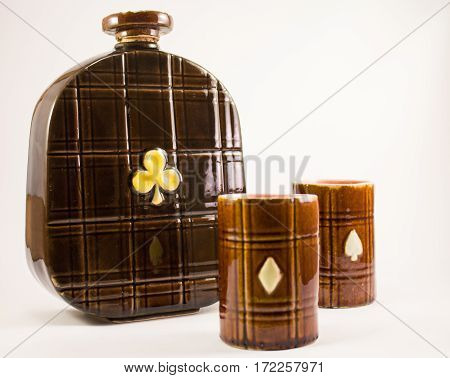 Old hand made decanter with two cups