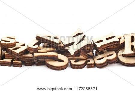 Line pile made of wood carved letters isolated over the white background, close-up crop fragment composition