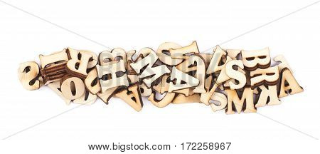 Pile of wood carved letters isolated over the white background