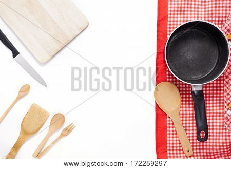 pot with cooking utensils on white background