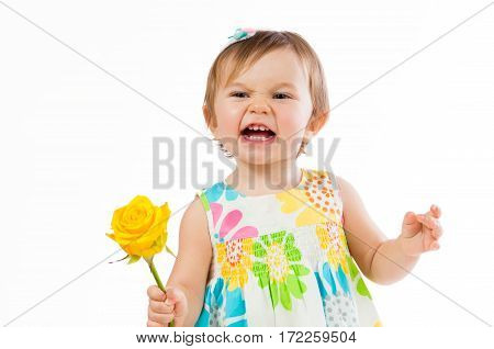 Indignant little girl with a yellow rose, romantic gift.