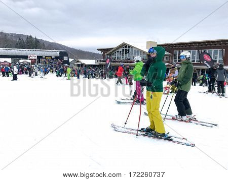 Stratton VT February 11 2017: Skiers at the bottom of the slopes of Stratton mountain near the main lodge.