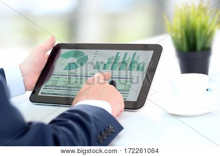 Businessman working with digital tablet in office