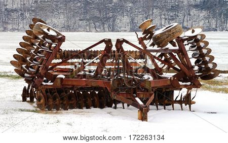Farm equipment on a snow covered field