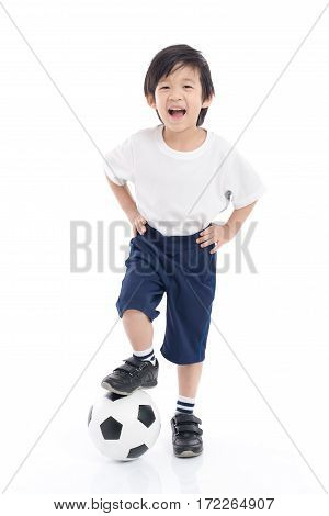 Cute Asian child with football on white background isolated