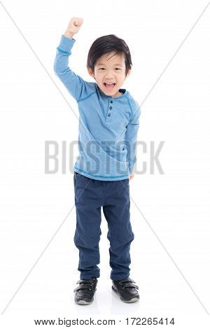 Cute Asian child showing winner sign on white background isolated