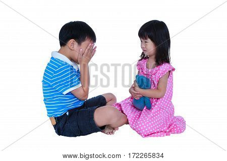 Quarreling conflict of child. Asian boy has problem between sister and crying sad girl sitting near by. Relationships difficulties in family concept. Isolated on white background. Studio shot.