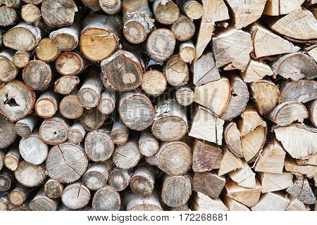 close up on stacking fire wood in winter
