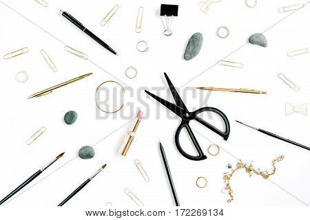 Home office table with scissors clips and female accessories. Flat lay top view. Fashion background.