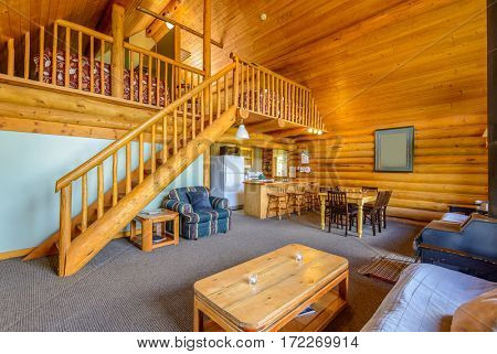 Modern dining room in log cabin or luxury house.