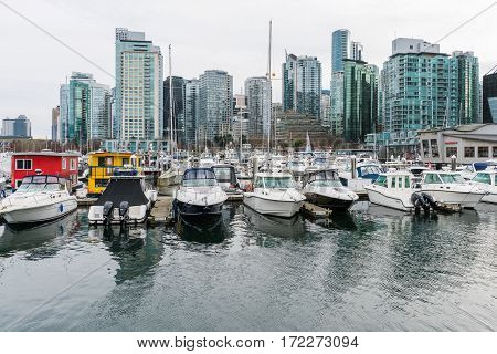 Vancouver Canada - January 28 2017: Vancouver city skyline with boats in foreground