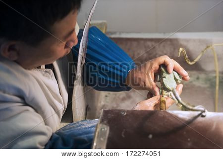 BEIJING December 28 2016: Picture of a Chinese person makes engraving jade